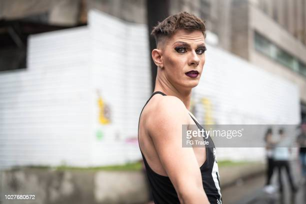 gay man at city street - drag queen stock pictures, royalty-free photos & images