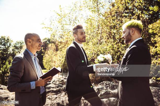 gay marriage, man putting the ring - community engagement stock pictures, royalty-free photos & images