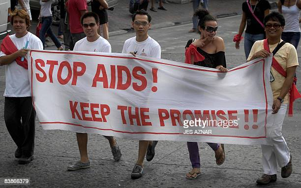 Gay members of the Olongapo City Aids Council Advocates Group display banners during a march to mark World Aids Day in Olongapo city, Zambales,...