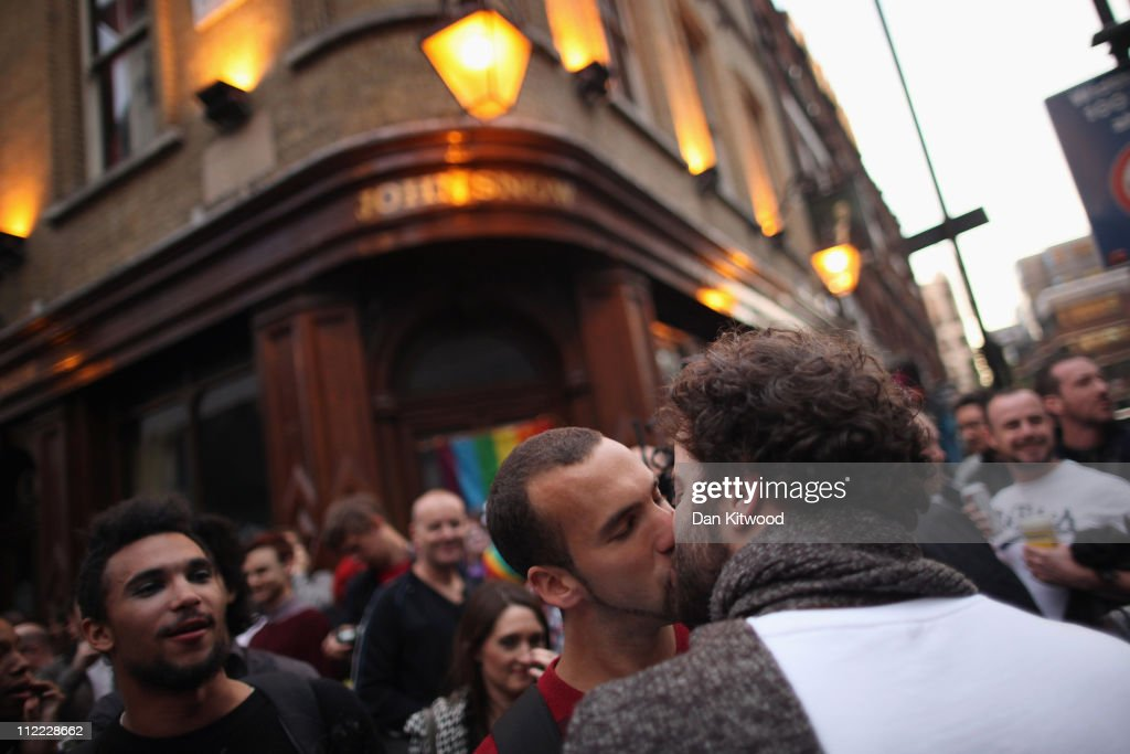 Protestors Take Part In A Group Kiss Outside A Pub After A Gay Couple Were Ejected : News Photo