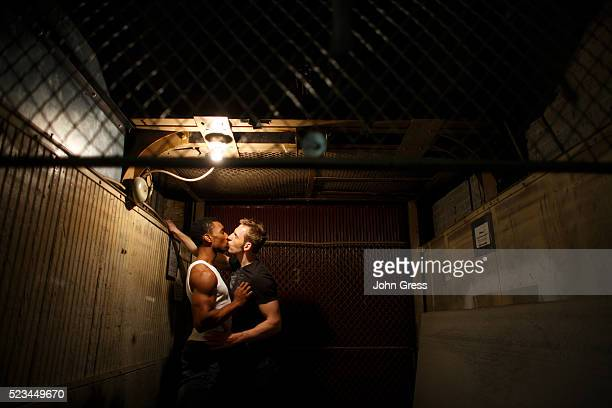Gay Men Kissing in Basement