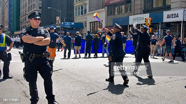 Gay New York City cops marching in the Manhattan gay parade celebrating their ability to acknowledge their sexual preference in public. On the left a...