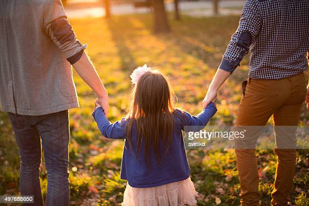 gay parents with daughter - adoptie stockfoto's en -beelden