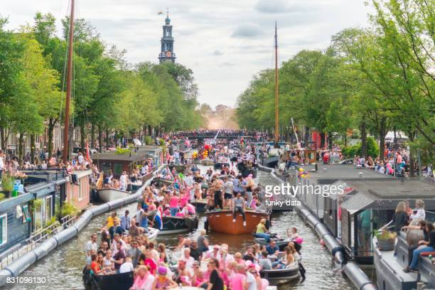 gay pride canal parade amsterdam - pride stock pictures, royalty-free photos & images
