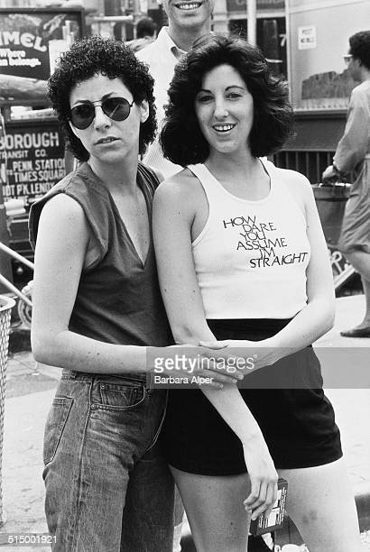 Gay Pride Day in New York City, June 1982. One woman wears a t-shirt with the slogan 'How dare you assume I'm straight'.