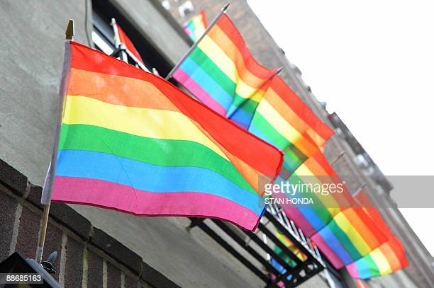 Gay pride flags fly from the Stonewall Inn on Christopher Street June 23 2009 in the Greenwich Village section of New York as the community marks the...