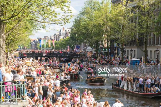 Gay pride parade in Prinsensgracht canal, Amsterdam, Netherlands