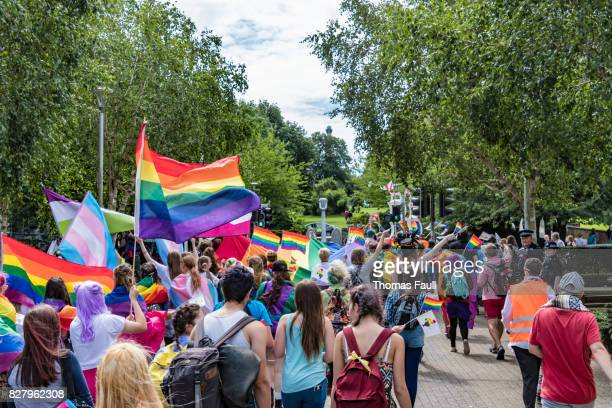 Gay Pride Parade passes with lots of flags
