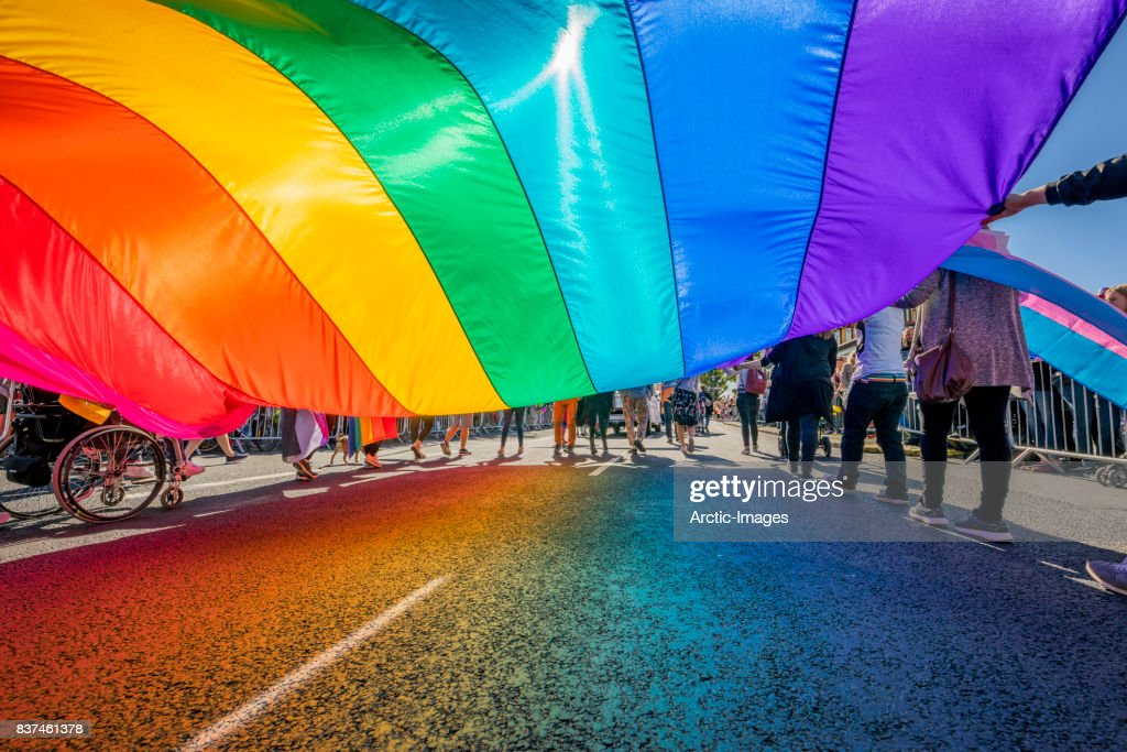Gay Pride Parade-People marching with a large Flag, Reykjavik, Iceland : ストックフォト