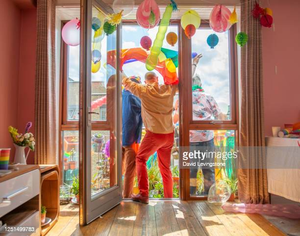 gay pride party at home - pride stock pictures, royalty-free photos & images