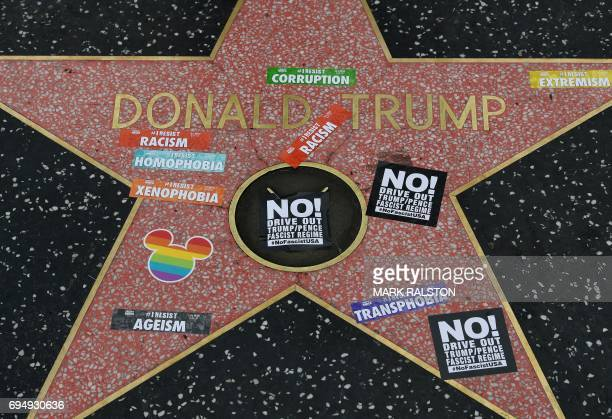 Gay pride stickers placed on the Hollywood Walk of Fame Star of President Donald Trump before the start of #ResistMarch during the 47th annual LA...