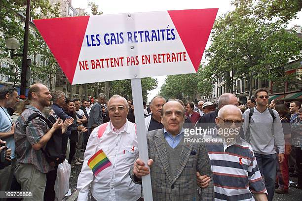 Gay retired men demonstrate 24 June 2000 in Paris during the 2000 Gay Pride holding a sign reading 'Gay retired don't retire' Tens of thousands of...