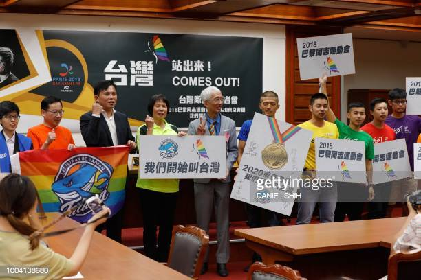 Gay rights activist Chi Chiawei lawmaker Huang Kuochang and others hold placards in support of Taiwanese athletes participating in the Paris 2018 Gay...