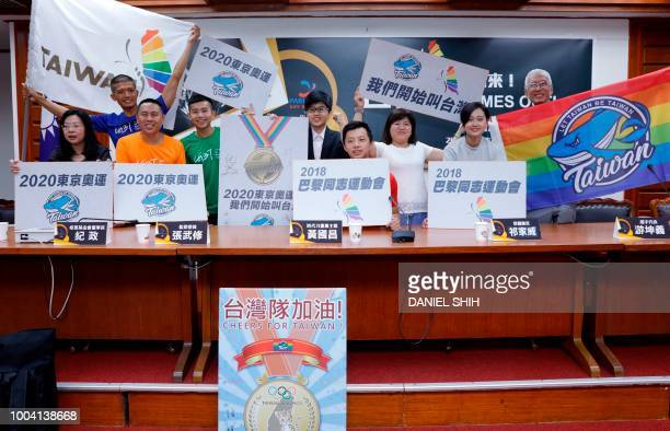 Gay rights activist Chi Chiawei Taiwan Gay Sports and Gay Development Movement Association president Yang Chihchun and others pose for photos as they...