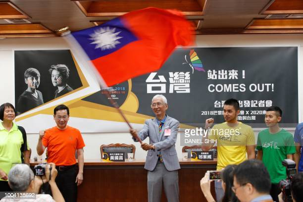 Gay rights activist Chi Chiawei waves a Taiwan flag in support of Taiwanese athletes participating in the Paris 2018 Gay Games during a press...