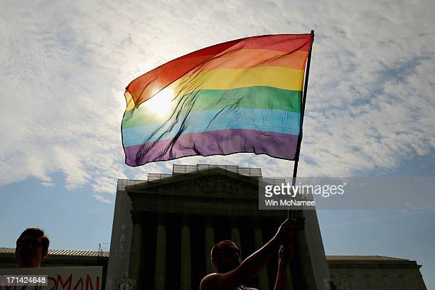 Gay rights activist Vin Testa of DC waves a flag in front of the US Supreme Court building June 24 2013 in Washington DC The high court is expected...