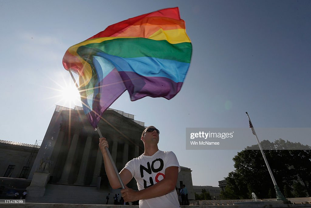 Gay rights activist Vin Testa of DC waves a flag outside the U.S. Supreme Court building on June 25, 2013 in Washington, DC. The high court convened again today to rule on some high profile decisions including two on gay marriage and one on voting rights.