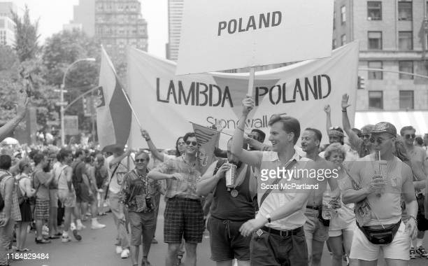 Gay rights activists from the 'Lambda Poland' LGBTQ organization walk along Central Park South during the Gay Pride March New York New York June 26...
