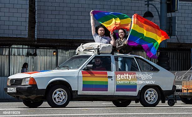 Gay rights activists hold rainbow flags during their protest in central Moscow on May 31 2014 Riot police on May 31 arrested two women as a small...