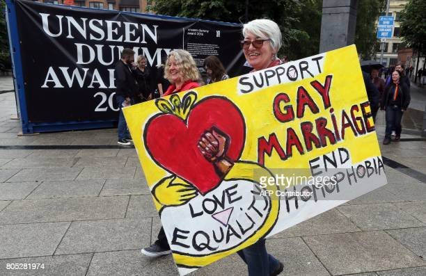 Gay rights campaigners take part in a march through Belfast on July 1 2017 to protest against the ban on samesex marriage PHOTO / Paul FAITH