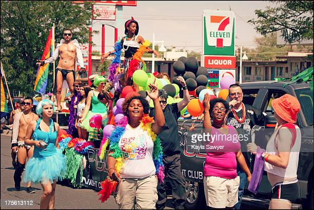 CONTENT] gay rights parade dancers dancing singing street Albuquerque New Mexico costumes Pride parade women men protest support community equality...