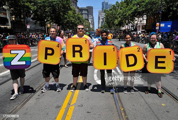 Gay rights supporters display a theme related to the popular Words With Friends game along the parade route at San Francisco's Gay Pride festival in...