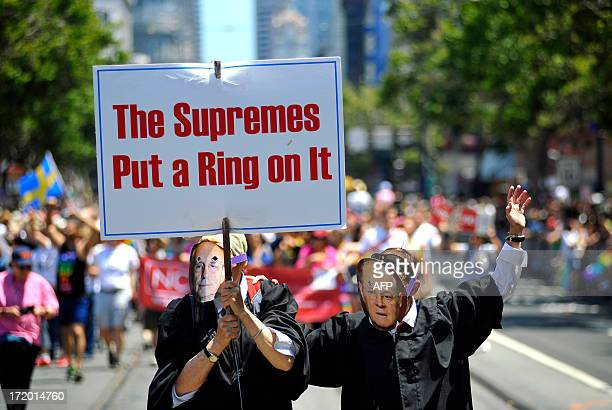 Gay rights supporters dressed as United States Supreme Court Justices march during San Francisco's Gay Pride festival on June 2013 AFP PHOTO / JOSH...