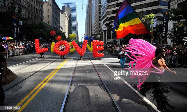 Gay rights supporters march along the parade route during San Francisco's Gay Pride festival on June 2013 AFP PHOTO/JOSH EDELSON