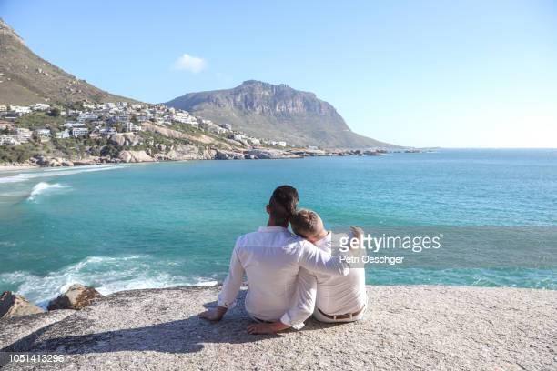 gay wedding by the sea. - beautiful gay men photos et images de collection