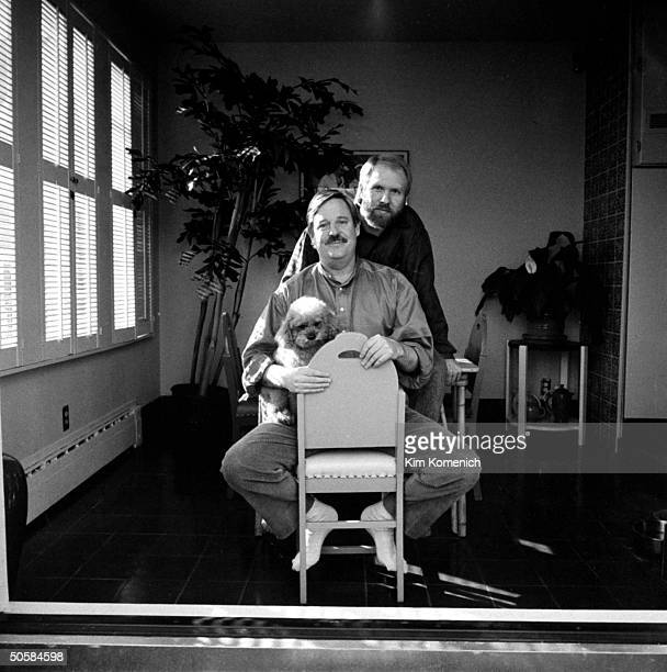 Gay writer Armistead Maupin in chair w lover Terry Anderson HIVpositive whose AIDS is under control w AZT w their dog Willie