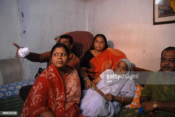Gayatri Devi, , mother of Railways Minister Mamata Banerjee, and her relatives watch the Railways Budget speech on television at her residence in...
