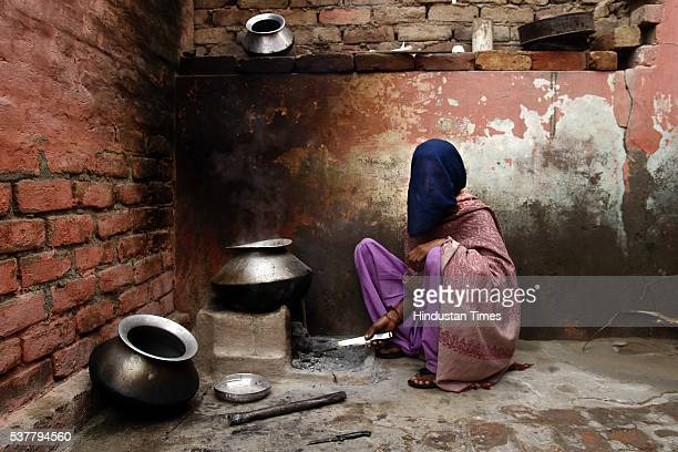 Gayatri one of the trafficked girls who were lured into marriage by traffickers cooking food at her house on March 15 2014 in Jind India Trafficked...