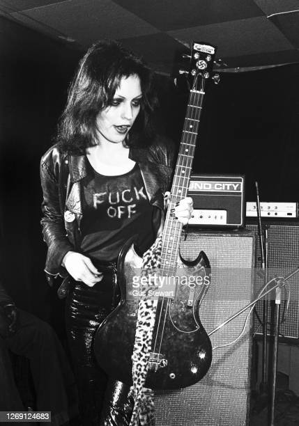Gaye Advert of punk band The Adverts, performs on stage as support to The Jam at The Roxy, London, England, on 15th March 1977. The slogan on her...