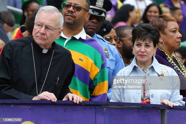 Gayle Benson owner of the New Orleans Saints and Gregory Michael Aymond Archbishop of New Orleans watch parades during Fat Tuesday celebrations on...