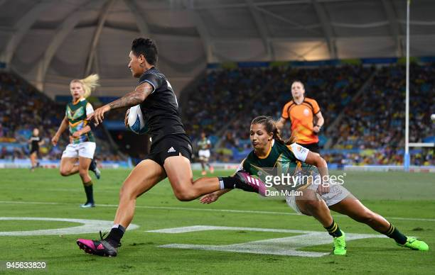 Gayle Broughton of New Zealand makes a break to score during the Rugby Sevens Women's Pool A match between New Zealand and South Africa on day nine...