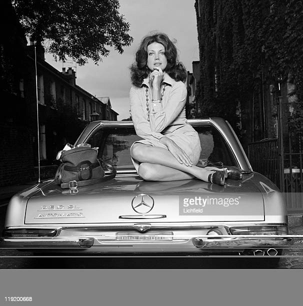 Gayle Hunnicutt American actress sitting on the boot of a Mercedes car 21st July 1977