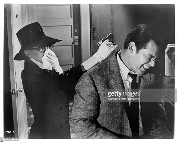 Gayle Hunnicutt pistol whips James Garner in a scene from the film 'Marlowe' 1969