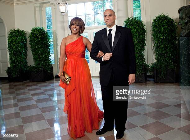 Gayle King and Cory Booker Mayor of Newark New Jersey arrive at the White House for a state dinner May 19 2010 in Washington DC President Barack...