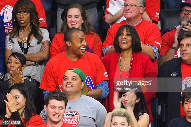 Gayle King and her son William Bumpus Jr attend a basketball game between the San Antonio Spurs and the Los Angeles Clippers at Staples Center on...