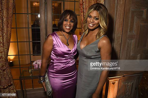 Gayle King and Laverne Cox attend the Bloomberg Vanity Fair cocktail reception following the 2015 WHCA Dinner at the residence of the French...