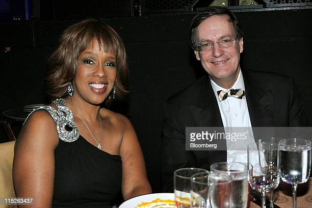 Gayle King, television personality and editor-at-large of O magazine , left and Peter A. Weinberg, partner and co-founder of Perella Weinberg...