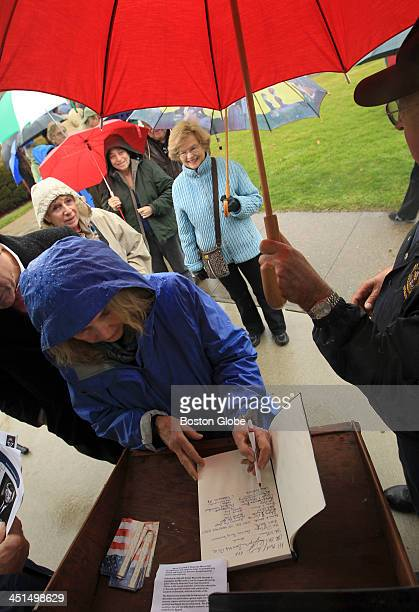 Gayle Peterson of Harwichport Mass was among those who lined up to sign a guest book before a wreath laying ceremony at the John F Kennedy Memorial...