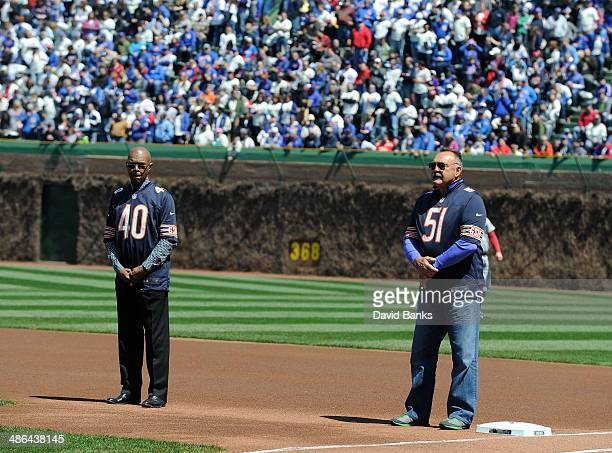 Gayle Sayers and Dick Butkus during pre game festivities on the birthday of the ballpark on April 23 2014 at Wrigley Field in Chicago Illinois Today...