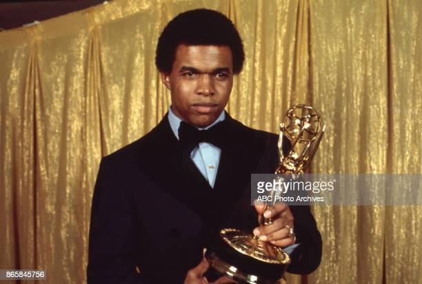 Gayle Sayers holding his Emmy Award in the press room at The 24th Primetime Emmy Awards on May 6 1972 at Pantages Theatre Los Angeles California