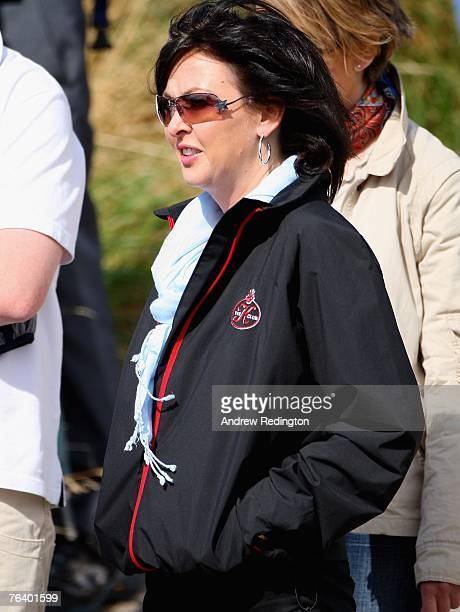 Gaynor Knowles watches her fiance Colin Montgomerie during the first round of The Johnnie Walker Championship on The PGA Centenary Course at...
