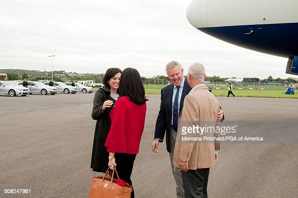 Gaynor Montgomerie and Colin Montgomerie greet Lisa Pavin and Corey Pavin at the 38th Ryder Cup at the Cardiff Airport in Cardiff Wales on Monday...