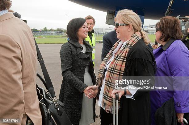 Gaynor Montgomerie greets Gail Wronowski and Stephanie Whitcomb at the 38th Ryder Cup at the Cardiff Airport in Cardiff Wales on Monday September 27...