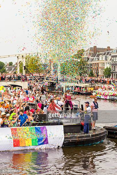 gaypride parade boats at magere brug - merten snijders stock pictures, royalty-free photos & images
