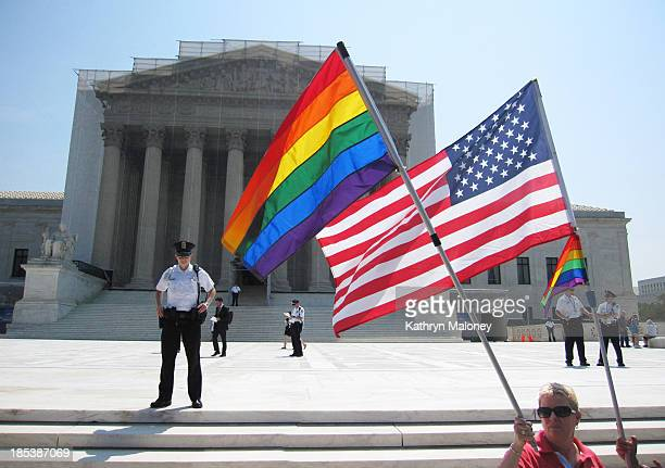 Gay-rights activists gathered outside of the Supreme Court on the morning when the Court handed down its decision to overturn the Defense of Marriage...
