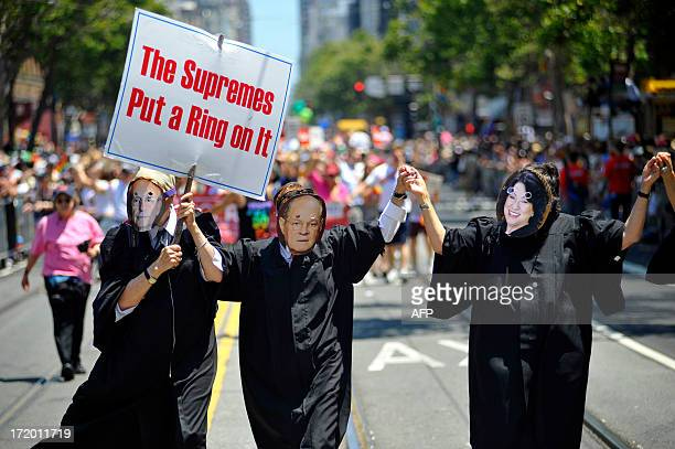 Gayrights advocates dressed as The United States Supreme Court Justices walk along the parade route at San Francisco's Gay Pride festival in...